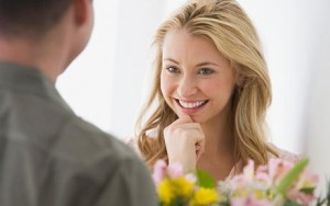 Woman receiving flowers from boyfriend
